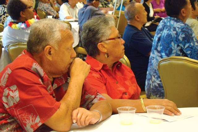 Retired Staff Sgt. Herring Kalua (left) and his wife, Sherry, listen attentively to presentations during RAD, held at Schofield's Nehelani, Oct. 6.