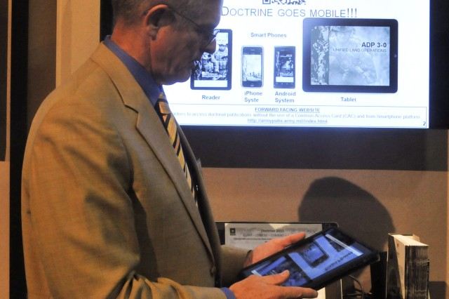 Clinton J. Ancker III, director, Combined Arms Doctrine Directorate, accesses current Army doctrine from his iPad demonstrating what is already accessible through the web browser.