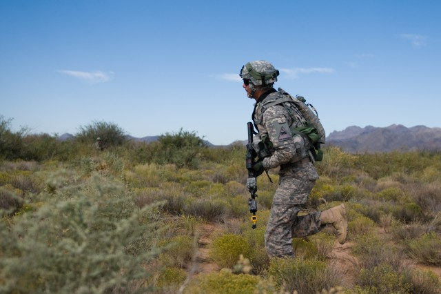 Pfc. Heriberto Lozano, a scout with Troop A, 1st Squadron, 1st Cavalry Regiment, 2nd Brigade Combat Team, 1st Armored Division, runs back to his base camp after conducting training on dismounted patrol and reconnaissance operations during the Network Integration Evaluation 13.1 at Doña Ana Range Complex, N.M., Oct. 16, 2012. (Photo by U.S. Army Sgt. Jonathan W. Thomas, 16th Mobile Public Affairs Detachment)