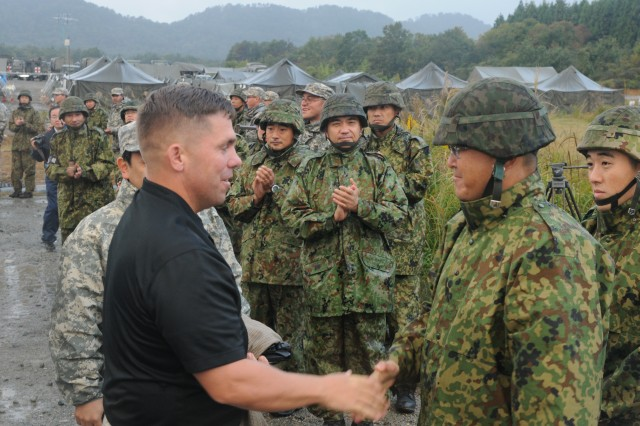 The commander of the 33rd Infantry Regiment, 10th Division, Middle Army, Japan Ground Self Defense Force, Col. Koji Furuya, welcomes Lt. Col. Jon Larsen, commander of 1st Battalion, 14th Infantry Regiment, 2nd Bde., 25th Infantry Division on October 23, 2012. The two commanders are leading their units in exercise Orient Shield 12. Exercise Orient Shield is an annual, tactical level, field-training exercise is co-hosted by U.S. Army Japan and the Ground Self-Defense Force.  This year's exercise is taking place at Aibano Training Area.