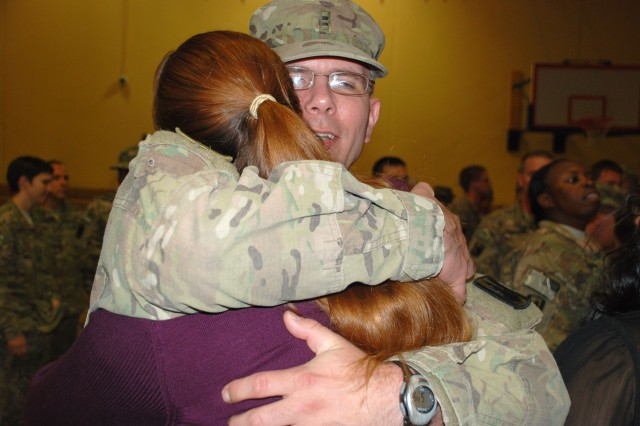 A Soldier hugs a loved one following dismissal of 14th Military Intelligence Battalion members. (U.S. Army photo by Gregory Ripps)