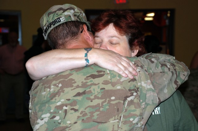 A Soldier and a loved one embrace following his return to Fort Sam Houston Oct. 21 after a year in Afghanistan. (U.S. Army photo by Gregory Ripps)