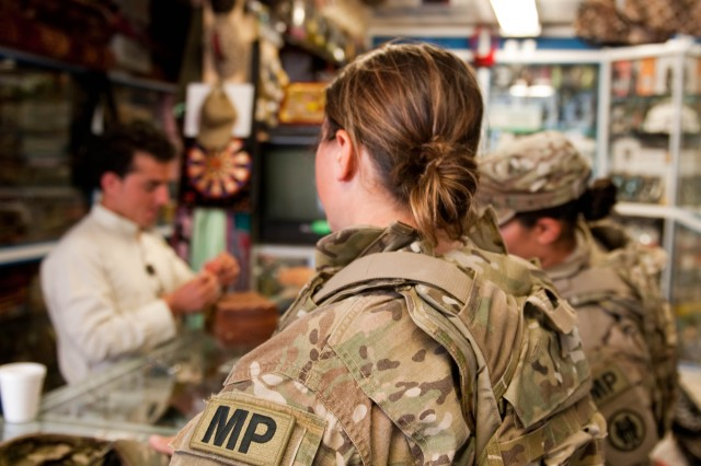 Cpl. Margie Jones (foreground) from Buckeye, Ariz., and Spc. Judy Sanchez (right) from Phoenix, Ariz., talk to a shop owner at Bagram Airfield, Afghanistan, Sept. 3, 2012. Jones and Sanchez are both military police officers with the 539th Military Police Detachment out of Buckeye, Ariz., and are practicing community policing by talking to a local shop owner on Bagram Airfield.