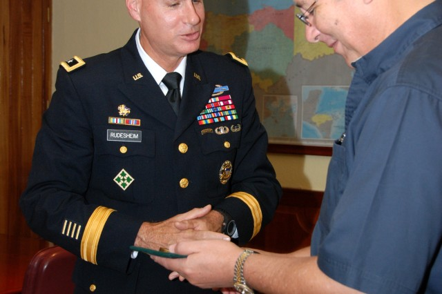 Maj. Gen. Frederick S. Rudesheim (left), U.S. Army South commanding general, visits with Honduran Minister of Defense Marlon Pascua Cerrato at the Honduras joint staff headquarters at Tegucigalpa, Honduras, Oct. 4, 2012.