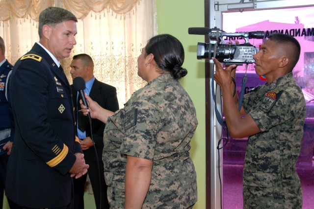 Maj. Gen. Frederick S. Rudesheim (left), U.S. Army South commanding general, is interviewed by Honduarn army reporters at the Honduran army headquarters at Tegucigalpa, Honduras, Oct. 4, 2012.