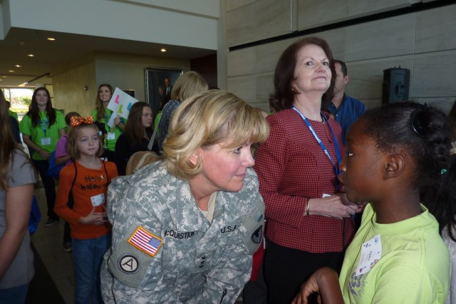 Lt. Gen. Patricia E. McQuistion, AMC Deputy Commanding General, talks with 4th grader Dyani Peters about what it's like to be an Army General at the Girls' Science & Engineering Day, October 20th.