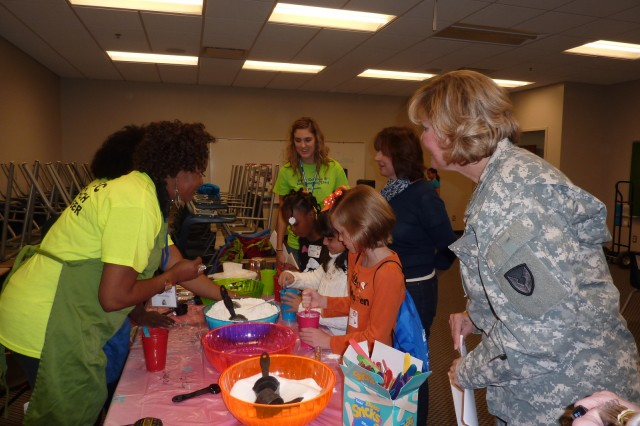 Lt. Gen. Patricia E. McQuistion, AMC Deputy Commanding General, and Dr. Grace M. Bochenek, AMC Chief Technology Officer, observe as participants make home-made playdough propellant and learn about rocketry.