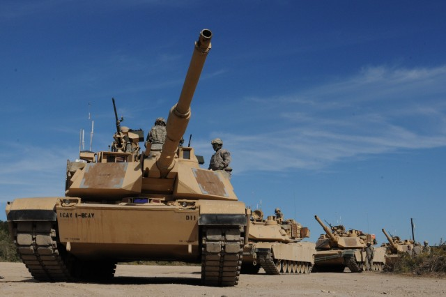 FORT HOOD, Texas -- M1A2 Abrams tank crews from the 1st Battalion, 8th Cavalry Regiment, 2nd Brigade Combat Team, 1st Cavalry Division, position their tanks in firing order before crew qualification during a Gunnery Table VI live-fire exercise at Clabber Creek Multiuse Range, here Oct. 18.