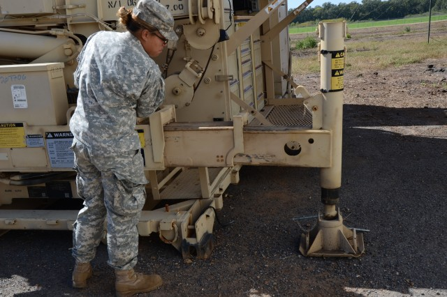 Spc. Angelica Antiporda, a quartermaster and chemical equipment repairer with the Company E, 4th Battalion, 101st Aviation Regiment, moves the controls to properly seat the legs of the forward repair system in the landing legs Oct. 19 during training at the Joint Readiness Training Center near Fort Polk, La. Daily training, conducted in realistic environments, under realistic circumstances, ensures our forces maintain the highest levels of proficiency and readiness for worldwide deployment. (U.S. Army photo by Sgt. Shanika L. Futrell, 159th Combat Aviation Brigade Public Affairs/RELEASED)