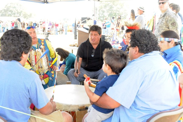 Rick Bird, center, event master of ceremonies, leads a group of Native American drummers during songs for the annual Honor Our Armed Forces Native American PowWow in Daleville Nov. 13.