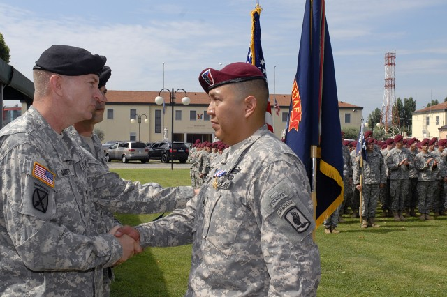 Having just fastened a Silver Star on the uniform of Staff Sgt. Conrad Begaye (right) from 2nd Battalion, 503rd Infantry Regiment, Maj. Gen. William B. Garrett III, commander of U.S. Army Africa, shakes Begaye's hand during a ceremony on June 30, 2009. Begaye was awarded the Silver Star for his valorous actions during an enemy ambush Nov. 9, 2007, in the Nuristan Province of Afghanistan.