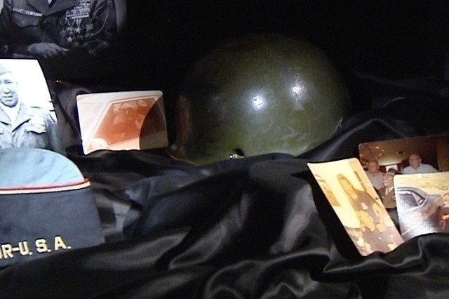 Master Sgt. Woodrow Wilson Keeble's helmet with a bullet hole from Korea is on display with other memorabilia at Russell Hawkins' home in South Dakota.