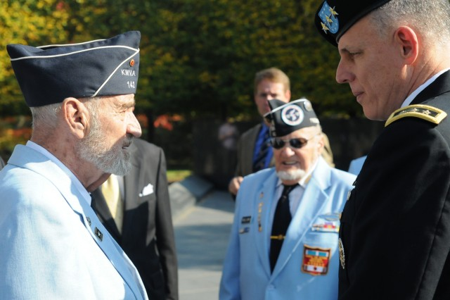 Eighth Army Commanding General Lt. Gen. John D. Johnson talks to a Korean War veteran at a wreath-laying ceremony in Washington, D.C., Oct. 23, 2012.