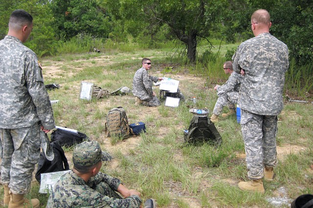 Captains in a previous Maneuver Captains Career Course seminar conduct a Tactical Exercise Without Troops on Bush Hill. Many MCCC classes have more than 20 international students.