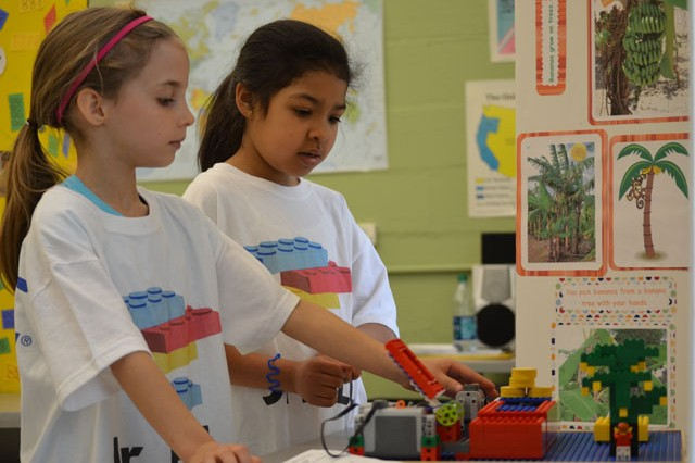 "Kaley McColligan and Iliania Clavijo from the APG Junior First Lego League team ""Spunky Monkeys"" make last minute adjustments during a Jr. FLL competition held at the Eagle Cove School in Pasadena, Md., during the last school year."