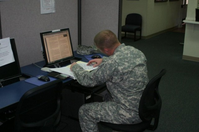 Sgt. 1st Class Joel Kramer, 2-13th Aviation Regiment, uses the computers available in the multi-use learning facility at the Education Center. This facility provides convenient study time during lunch or after work.