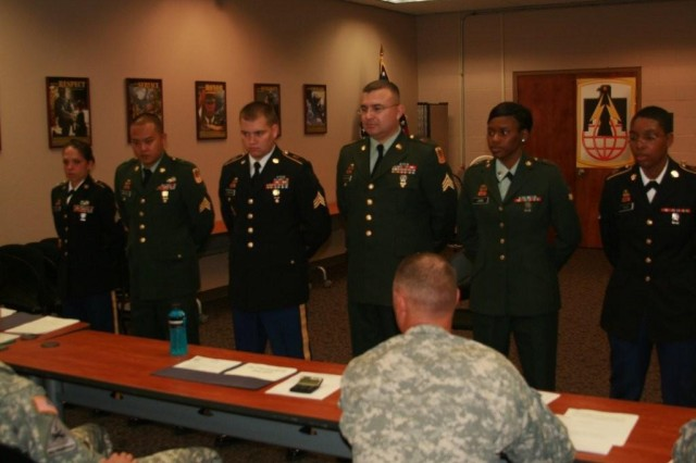 Soldiers stand in front of board members after completing the first phase of the 11th Tactical Theatre Signal Brigade's Chef of the Year 2012 Competition Oct. 16. Soldiers took part in a two-day event to determine the brigade's best Noncommissioned officer Chef of the Year and Soldier Chef of the Year.