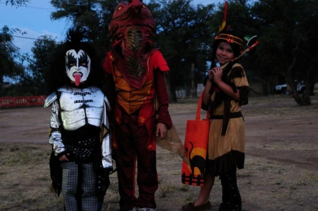 """Dragon Jolie Hite, 10, her sister, Indian princess Alissa, 8, and her little brother, Aiden in the Kiss-costume, 5, came with their parents to enjoy the Halloween event celebrated last Friday and Saturday at Wren Arena from 6 """" 10 p.m."""