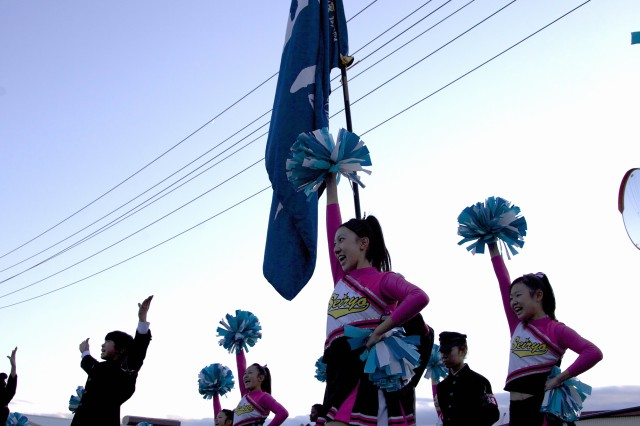 A cheering squad or - oendan, from nearby Seiryo High School performs a routine in support of the Zama American High School football teams Oct. 19.