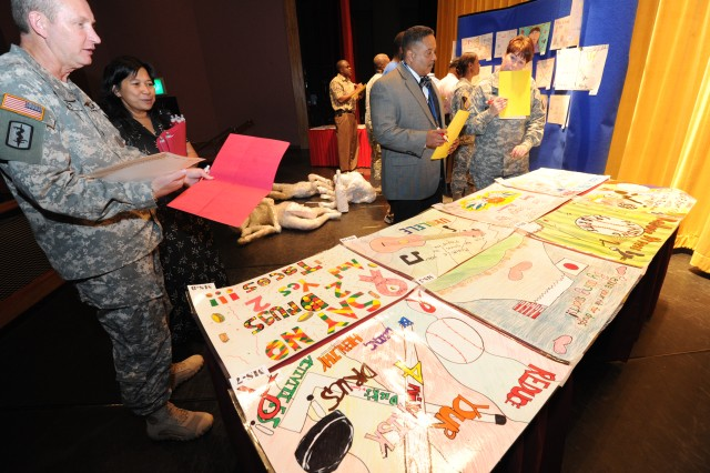 The judges including Soldiers, Civilians and Family members take a good look at each artwork done by the students at Camp Zama during the Red Ribbon Week Art Contest at the Community Activity Center Oct. 23.