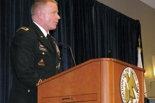 Brig. Gen. David J. Bishop, commander of Warrior Transition Command, updates Soldiers and family members about all the ways WTC is helping wounded warriors transitioning out of the Army find employment during a family form at the 2012 Association of the United States Army Annual Meeting and Exposition, Oct. 23, 2012, in Washington, D.C.
