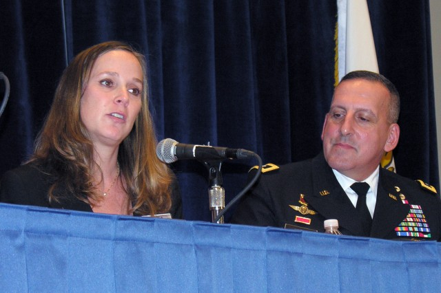 Catherine Mogil, Ph.D., and Maj. Gen. John Uberti, the deputy commanding general for support at Installation Management Command, discuss some of the challenges wounded warriors and their families face during a family form at the 2012 Association of the United States Army Annual Meeting and Exposition, Oct. 23, 2012, in Washington, D.C.