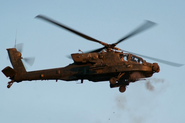 Soldiers from 1st Bn., 2nd Avn. Regt., fire 30mm bullets from an AH-64D Apache helicopter M230 chain gun Oct. 13, 2011, during gunnery exercises at Fort Carson, Colo.