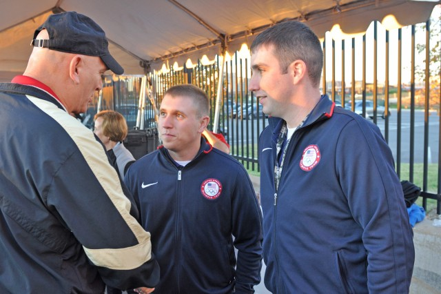 Sgt. Vincent Hancock (middle), and Staff Sgt. Josh Richmond (right), with the U.S. Army Marksmanship Unit, talk with Army Chief of Staff Raymond T. Odierno moments before the start of the 28th Annual Army Ten-Miler, Oct. 21, 2012. The USAMU Soldiers, along with Sgt. 1st Class Josh Olson, were in town telling their Army and Olympic stories and were recognized at several venues during their time in town. Hancock won his second Olympic Gold medal in London, Aug. , 2012.