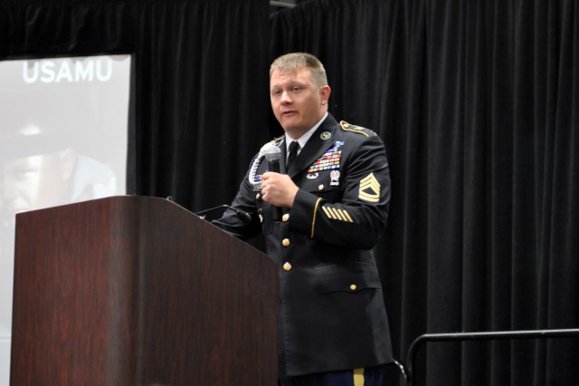 "Sgt. 1st Class Josh Olson, U.S. Army Marksmanship Unit, gives a presentation at the Association of the United States Army Annual Meeting and Exposition, Oct. 23, 2012. Olson, along with Sgt. Vincent Hancock, spoke to an audience about ""Representing the Nation -- Training the Warfighter,"" discussing the capabilities of the U.S. Army Marksmanship Unit."