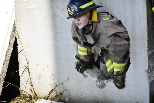 An Arrowhead Ranch resident struggles to climb out of a series of partially obstructed tunnels used by Rock Island Arsenal Firefighters to train in arduous conditions. The Arrowhead Ranch visited the Arsenal on Oct. 24-25. (Photo by Sgt. 1st Class Sean Riley, ASC Public Affairs)