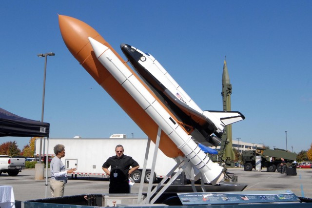 A mockup of the Space Shuttle Endeavor, staffed by Ola Metcalfe of NASA on the left, is displayed at Bridge Street Town Centre on Oct. 15 as part of the 50th anniversary celebration of Cummings Research Park. Metcalfe is talking with onlooker Larry Grosberg, who is employed by the Army.