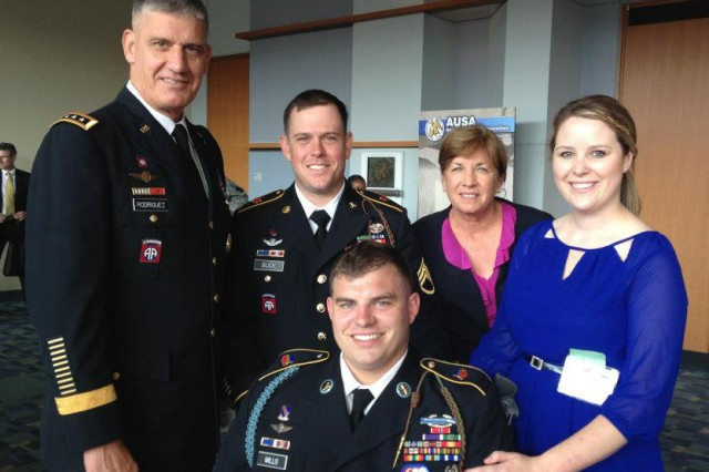 Gen. David M. Rodriguez and his wife Ginny met with Staff Sgt. Travis Mills and his wife Kelsey during this year's Association of the United States Army annual meeting and exposition. Mills is a member of the 82nd Airborne Division recovering at Walter Reed Army Medical Center from life-threatening injuries sustained earlier this year during his third deployment to Afghanistan. Mills, a quadruple amputee, and his wife were honored guests at the Oct. 23 AUSA Eisenhower Luncheon, where Chief of Staff of the Army Gen. Raymond T. Odierno introduced Mills and his wife during his remarks.  Odierno thanked them both for their service to the nation and the tremendous sacrifices they continue to endure. Also pictured is Mills' brother-in-law, Staff Sgt. Josh Buck, who is also assigned to the 82nd Airborne Division.