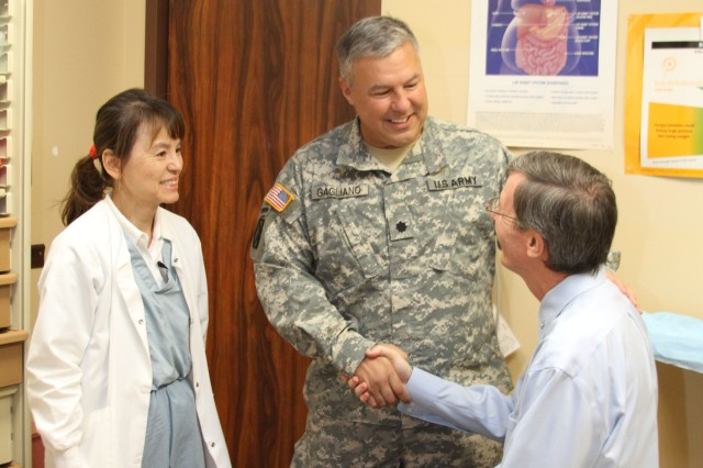 TRIPLER ARMY MEDICAL CENTER, Hawaii - Daniel Shockley (right), a retired Sailor living on Oahu, meets with Lt. Col. Ronald Gagliano (center), chief, Colon and Rectal Surgery and director, Surgical Research, TAMC, and Nina Lum, certified wound, ostomy and continence nurse, TAMC, to discuss recovery and post-operative care following his proctocolectomy with ileostomy surgery, which removed portions of his large intestine to include the entire colon, rectum and anus. In mid-2012 Shockley was diagnosed with Attenuated Familial Adenomatous Polyposis, a condition in which numerous polyps form mainly in the large intestine and increases the risk of colorectal cancer.