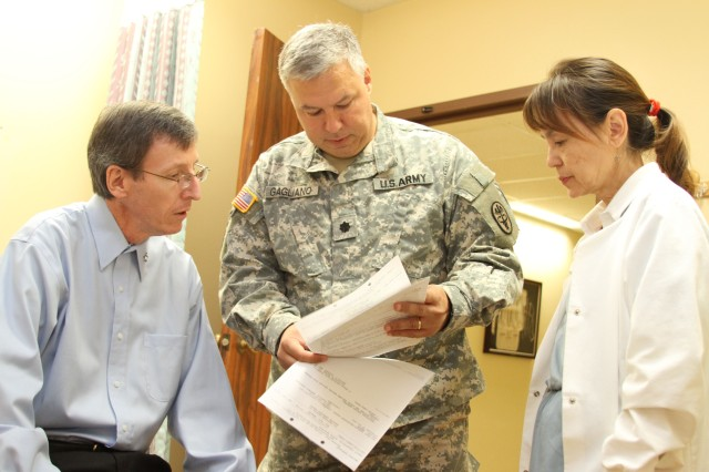 TRIPLER ARMY MEDICAL CENTER, Hawaii - Daniel Shockley (left), a retired Sailor living on Oahu, meets with Lt. Col. Ronald Gagliano (center), chief, Colon and Rectal Surgery and director, Surgical Research, TAMC, and Nina Lum, certified wound, ostomy and continence nurse, TAMC, to discuss recovery and post-operative care following his proctocolectomy with ileostomy surgery, which removed portions of his large intestine to include the entire colon, rectum and anus. In mid-2012 Shockley was diagnosed with Attenuated Familial Adenomatous Polyposis, a condition in which numerous polyps form mainly in the large intestine and increases the risk of colorectal cancer.