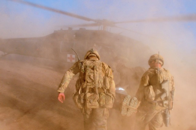 Australian Army Soldiers load an injured Soldier onto a UH-60 Black Hawk from Company C, 3rd Battalion, 25th Aviation Regiment, Task Force Gunfighters, 25th Combat Aviation Brigade, during a medical evacuation training mission at Multinational Base Tarin Kowt, Afghanistan, Oct. 1, 2012.