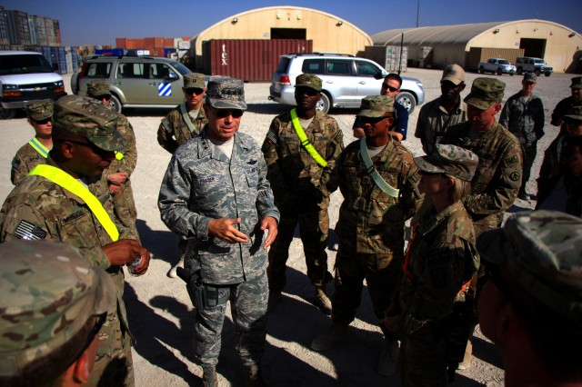 Gen. William M. Fraser III discusses process of materiel transportation from the Kandahar Airfield Retrosort Yard with Soldiers of the 593rd Sustainment Brigade and the 18th Combat Sustainment Support Battalion. (U.S. Army photo by 2nd Lt. Henry Chan, 18th Combat Sustainment Support Battalion Public Affairs)