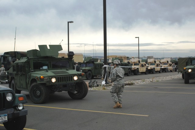 "LATHAM, NY""New York Army National Guard Soldiers assigned to the 206th Military Police Company prepare to move out on a road march from New York State Division of Military and Naval Affairs Headquarters here to the Farmingdale Armed Forces Reserve Center as part of the New York State response to Hurricane Sandy on Sunday, Oct. 28. The Soldiers are among more than 1,100 Army and Air National Guard Soldiers and Airmen deployed at the order of New York Governor Andrew M. Cuomo to respond to the storm."