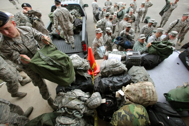 Airmen of the New Jersey National Guard's 108th Wing are processed in at Joint Base McGuire-Dix-Lakehurst, N.J., before being sent out to assist at various emergency shelters prior to the landfall of Hurricane Sandy, Oct. 28, 2012.