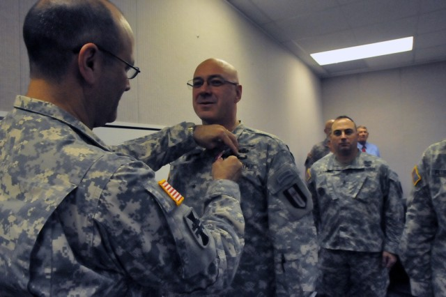 VICKSBURG, Miss.- Maj. Gen. William M. Buckler, Jr., commander of 412th Theater Engineer Command, pins the Legion of Merit on Brig. Gen. James T. Williams, for meritorious achievement during his previous assignment as deputy commander of 80th Training Command (Total Army School System), in a brief ceremony held here today. Williams, a resident of Monroe County, Ga., now serves as commander of 302nd Maneuver Enhancement Brigade in Chicopee, Mass.