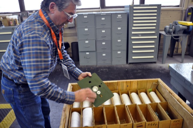 One of Watervliet's manufacturing general foremen, Paul Nieckarz, inspecting the packaging of M8 60mm baseplate being readied for shipment.  The new M7A2 60mm baseplate will not go into production until 2013.