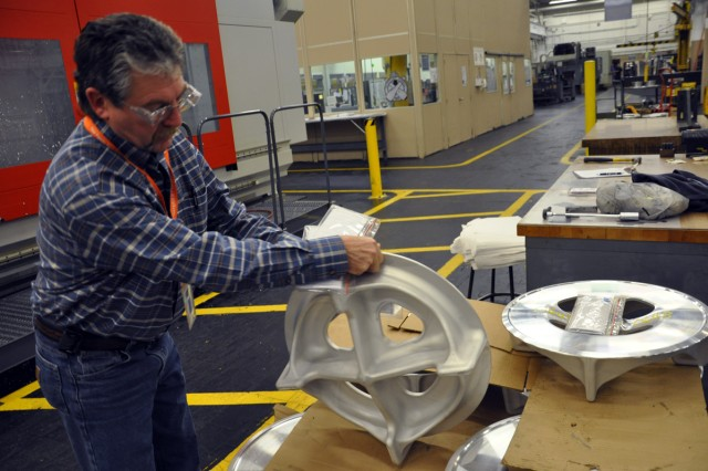 One of Watervliet's manufacturing general foremen, Paul Nieckarz, checking a 60mm baseplate casting being readied for machining.  The new M7A2 60mm baseplate will not go into production until 2013.