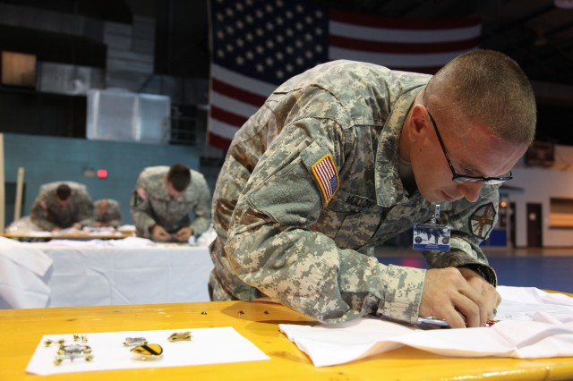 SGT Kevin Mulloy builds a rack of ribbons during the mystery event at the U.S. Army 2012 Best Warrior competition at Fort Lee, Va., Oct. 16, 2012. The mystery event consisted of competitors assembling awards and decorations onto the Army Service Uniform.