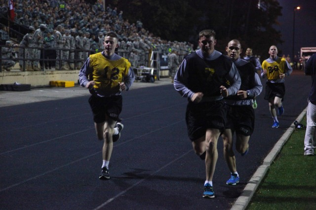 SSG Randy Roscoe leads a group through the darkness at Fort Lee, Va., Oct. 16, 2012, during the two-mile run event of the Army Physical Fitness Test at the U.S. Army 2012 Best Warrior competition. The Army Physical Fitness Test is designed to test the muscular strength, endurance, and cardiovascular respiratory fitness of Soldiers in the Army.