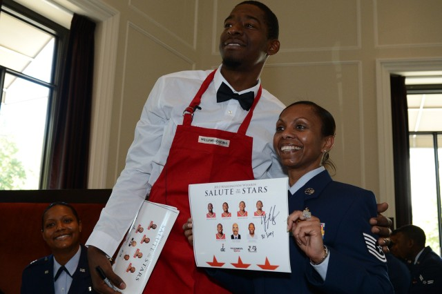 "Washington Wizards guard Jordan Crawford, once best known as the college kid who dunked on LeBron James during a summer pick-up game, poses with Air Force Tech. Sgt. Kathleen Ivey of Joint Base Andrews, Md., during ""Salute to the Stars,"" a luncheon to honor America's bravest at J&G Steakhouse inside the W Hotel in Washington, D.C., Oct. 22, 2012."