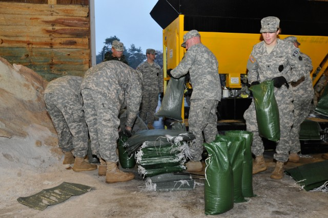 Massachusetts National Guardsmen fill sand bags Oct. 28, 2012, in preparation for Hurricane Sandy at the Massachusetts Department of Transportation facility.