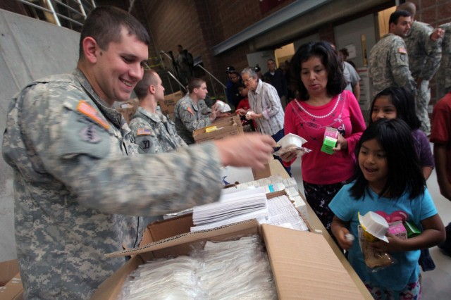 Sgt. Michael Ryno, along with Soldiers from the 50th Infantry Brigade Combat Team, New Jersey Army National Guard, mobilized for Hurricane Sandy provide assistance to displaced residents at an emergency shelter at the Werblin Recreation Center, Piscataway Township, N.J., Oct. 29, 2012.