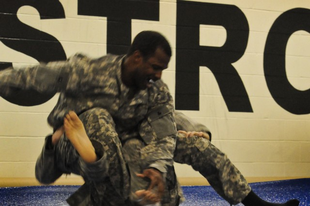 Soldiers practice their grappling techniques during the Army Sustainment Command's Level 1 Modern Army Combatives training at the Rock Island Arsenal Community Fitness Center, Oct. 1, on Rock Island Arsenal, Ill. (Photo by Sgt. 1st Class Sean Riley, ASC Public Affairs)