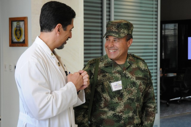 Dr. Raul Marin, a physiatrist at the Center for the Intrepid, speaks with Colombian Gen. Alejandro Navas, the commanding general of the Colombian Military Forces, about  the history and mission of the center during a visit Oct. 23 at the CFI on Fort Sam Houston, Texas. Navas was part of a delegation of Colombian soldiers and business leaders who visited U.S. Army South, Brooke Army Medical Center, the Center for the Intrepid and the Warrior and Family Support Center to gain valuable information that will assist them in creating a similar support network for Colombian troops wounded in combat. (U.S. Army photo by Eric R. Lucero, U.S. Army South Public Affairs)
