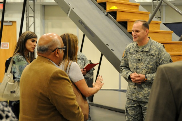 Lt. Col. Donald Gajewski, the Center for the Intrepid director, gives a brief on the history and mission of the center to a delegation of Colombian soldiers and business leaders Oct. 23 at the CFI on Fort Sam Houston, Texas. The Colombians visited U.S. Army South, Brooke Army Medical Center, the Center for the Intrepid and the Warrior and Family Support Center to gain valuable information that will assist them in creating a similar support network for Colombian troops wounded in combat. (U.S. Army photo by Eric R. Lucero, U.S. Army South Public Affairs)