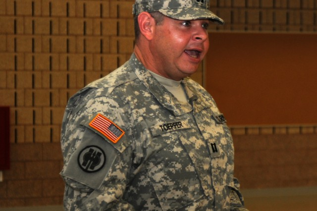 Capt. Allen Toepfer, commander of the 334th Chemical Company, a U.S. Army Reserve unit in Marysville, Wash., speaks at his unit's activation ceremony, Oct. 27, 2012. The unit was reactivated after nearly 47 years.